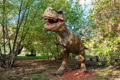 A huge prehistoric scary dinosaur. Stands in the attacking pose stock photography