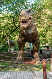 A huge prehistoric scary dinosaur. Stands in the attacking pose royalty free stock photo