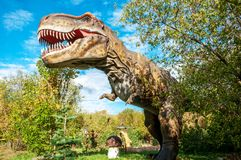 A huge prehistoric scary dinosaur. Stands in the attacking pose stock photos