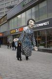 Huge puppet walks on New Arbat street in Moscow. MOSCOW - FEBRUARY 25, 2017: Huge puppet walks on New Arbat street in Moscow. Shrovetide Pancake week celebration Royalty Free Stock Photos