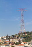 Huge pylon and power line above a residential area. Electric smog. High voltage electricity pylon and power line above a residential area Stock Photo