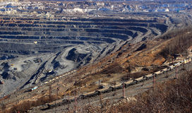Huge quarry for the extraction of iron ore from a moving train Gubkin Russian stock images