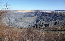 Huge quarry iron ore mining Gubkin Russian Spring. Huge quarry iron ore mining in Gubkin Russian spring Royalty Free Stock Images