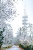 Huge radio tower during winter. On top of the hill Stock Photo