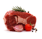 Huge raw ribeye steak garnished with spices Stock Photos