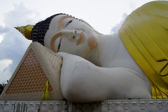 The huge Reclining Buddha be enshrined inside the temple Stock Photo