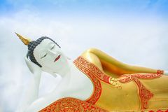 Huge reclining buddha image on blue sky with cloudy at Doi Kham temple in Chiang Mai of Thailand stock images
