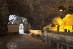 Huge reclining Buddha image in Khao Luang Cave,Phetchaburi province,Thailand. Khao Luang Cave is the largest and the most beautiful cave in Phetchaburi,Thailand Stock Image