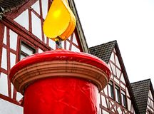 Huge red Christmas candle in front of Hessian half-timbered houses. In a small village Stock Photo