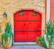 The red double door, Naxxar, Malta. The huge red double door of residential house in Naxxar town, Malta stock images