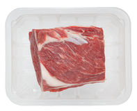 Huge red meat chunk in box isolated over white background Stock Photography