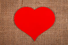 Huge red paper heart on burlap Stock Photo