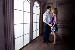 Huge  Renaissance windows illuminated  pregnant couple Royalty Free Stock Image