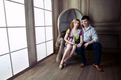 Huge  Renaissance windows illuminated  pregnant couple Royalty Free Stock Photos