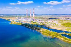 Huge river flowing near local power station aerial landscape royalty free stock photos