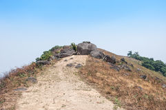 Huge rock block the road on peak of mountain. Taken from the north of Thailand Royalty Free Stock Photography