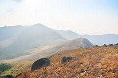 Huge rock block the road on peak of mountain. Taken from north of Thailand Royalty Free Stock Photos