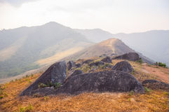 Huge rock block the road on peak of mountain. Taken from the north of Thailand Royalty Free Stock Photo