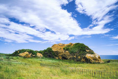 Huge Rock with Blue Sky - Huge Rock at Chaojing Park with morning blue bright sky, shot in Zhongzheng District, Keelung, Taiwan. Royalty Free Stock Photos