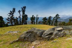 Bugyals, flat lands at upper Himalayas, Uttarakhand, India. Huge rock on Bugyal, alpine pasture lands, or meadows, in higher elevation range of Himalayas in stock photos