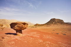 Huge rock in the heated desert. Huge rock from red sandstone in the form mushroom in the heated desert Stock Photo