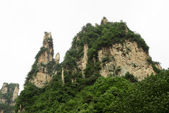 Huge Rock Mountains Surrounded by Green Trees. Epic Mountain Landscape Royalty Free Stock Photos