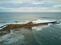 Huge rock in ocean beach Royalty Free Stock Image