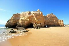 Huge rock at Praia da Rocha Portugal royalty free stock photography