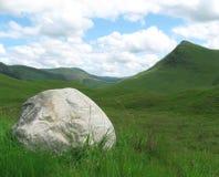 Huge rock in scottisch landscape. A huge boulder in a typical scottish landscape Royalty Free Stock Image