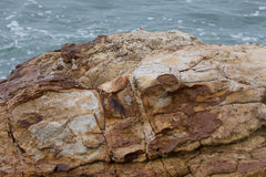 Huge rock and the sea in the background Royalty Free Stock Images