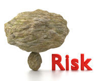 Huge rock on top of a small stone risk management Royalty Free Stock Images