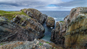 Huge rocks and boulder outcrops along Cape Bonavista coastline in Newfoundland, Canada. Huge rock & boulder outcrops along Cape Bonavista coastline in Royalty Free Stock Photo