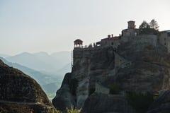 Huge rocks with christian orthodox monasteries at sunset above Meteora valley near Kalambaka, Thessaly stock photography