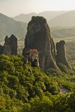 Huge rocks with christian orthodox monasteries at sunset above Meteora valley near Kalambaka, Thessaly royalty free stock images