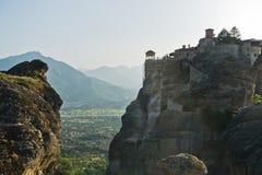 Huge rocks with christian orthodox monasteries at sunset above Meteora valley near Kalambaka, Thessaly royalty free stock image