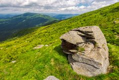 Huge rocks on the grassy mountain side. Wonderful summer landscape Stock Photos