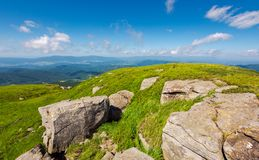 Huge rocks on the grassy mountain side. Wonderful summer landscape royalty free stock images