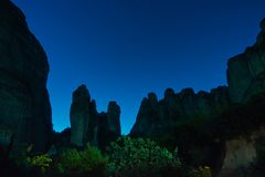 Huge rocks with starry sky in background at night, Meteora valley near Kalambaka, Thessaly royalty free stock photos