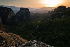 Huge rocks at sunset with Meteora valley in background, near Kalambaka, Thessaly stock images