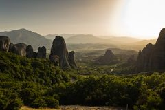 Huge rocks at sunset with Meteora valley in background, near Kalambaka, Thessaly royalty free stock photography