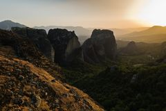 Huge rocks at sunset with Meteora valley in background, near Kalambaka, Thessaly royalty free stock photo