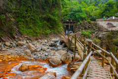 Huge rocks and a wooden bridge near the waterfall, Philippines. Valencia, island Negros. Royalty Free Stock Photos