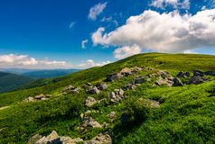 Huge rocky formation on the grassy hillside. Beautiful landscape of Runa mountain on a bright summer day royalty free stock photo