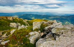 Huge rocky formations on the grassy hills. Beautiful mountain landscape in late summer on a cloudy day. location Runa mountain, Ukraine Royalty Free Stock Images