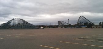 Huge roller coasters in an empty parking lot. At Mt. Olympus theme park in Wisconsin Dells, WI royalty free stock images