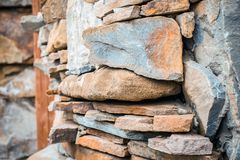 Huge rough mediterranean stone wall as background. Royalty Free Stock Photos