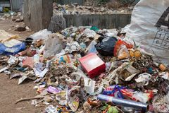 Big rubbish dump by the road at living area stock image