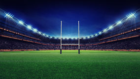 Huge rugby stadium with fans and green grass Royalty Free Stock Image
