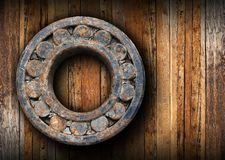 Huge rusty ball bearing hung on the wall Royalty Free Stock Image