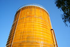 Huge, rusty gas tank in morning sun Royalty Free Stock Photo